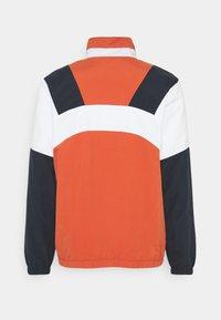 Ellesse - GONZAGA JACKET - Lehká bunda - dark orange - 1