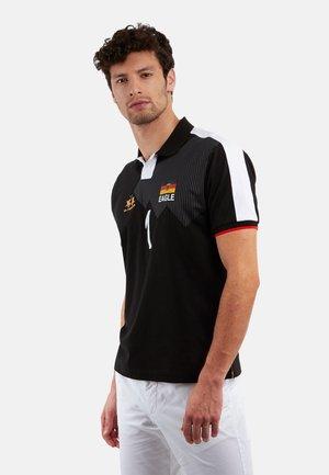 PHILO - Polo shirt - black