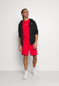 Champion - BERMUDA - Sports shorts - red - 1