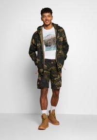 Bogner Fire + Ice - CLIO - Sports shorts - dark green - 1