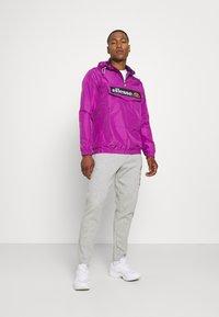 Ellesse - Windbreaker - purple - 1