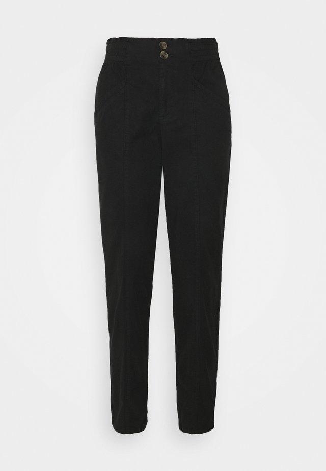 RUFFLE - Trousers - black