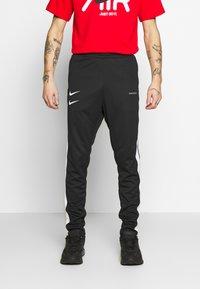 Nike Sportswear - Pantaloni sportivi - black/white - 0