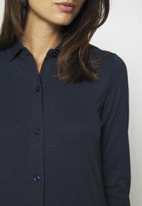 Marc O'Polo - DRESS LONG SLEEVE COLLAR BUTTON PLACKET - Jersey dress - midnight blue - 6