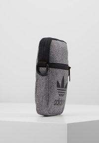 adidas Originals - MEL FEST BAG - Across body bag - black/white - 3