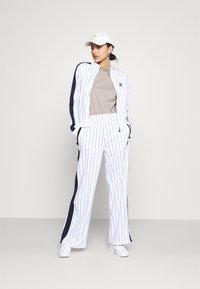 Fila - HALA TRACK PANTS - Trousers - blanc de blanc/black iris - 1