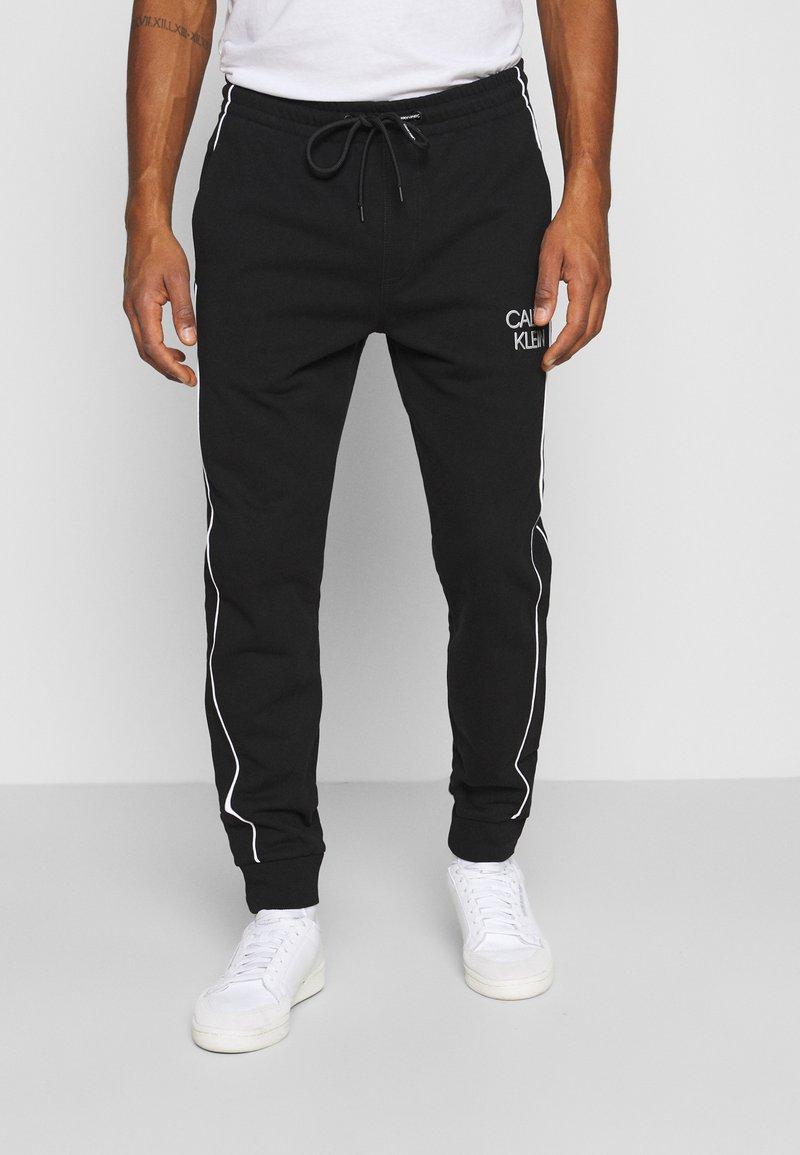 Calvin Klein - TWO TONE LOGO PANT - Tracksuit bottoms - black