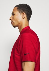Nike Golf - DRY SPEED - Sports shirt - gym red/white