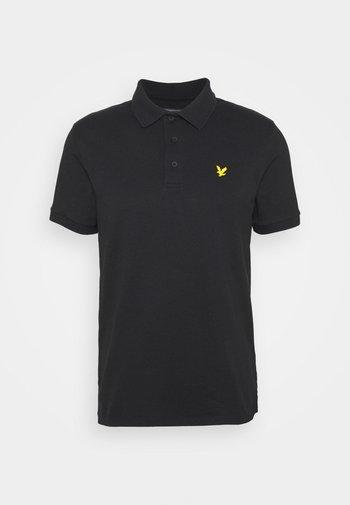 SLEEVE LOGO - Poloshirt - true black