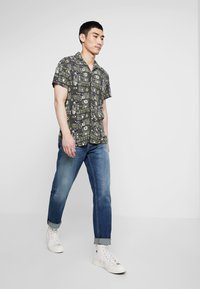 Nudie Jeans - STEADY EDDIE II - Straight leg jeans - indigo shades - 1