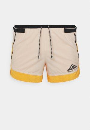 TRAIL - Sports shorts - solar flare/beach/black