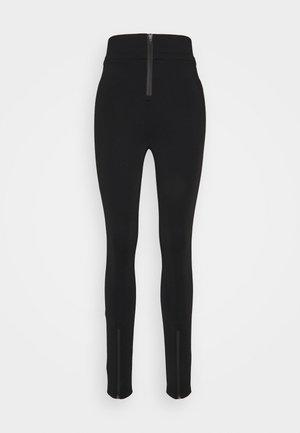 THE DEFENSIVE PANT - Leggings - Trousers - black