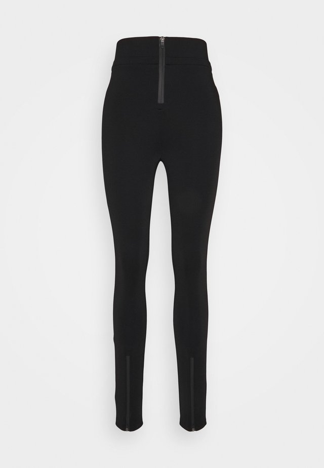 THE DEFENSIVE PANT - Leggings - black