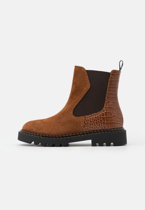 PECHINO - Platform ankle boots - cognac