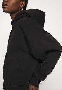 Gestuz - RUBI HOODIE - Sweatshirt - black - 4
