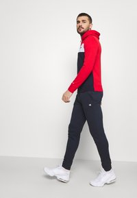 Champion - HOODED FULL ZIP SUIT - Tracksuit - red/dark blue - 5