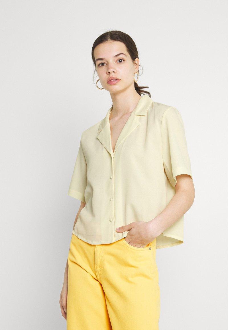 Monki - TANI BLOUSE - Blouse - yellow dusty light