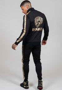Ed Hardy - LOVE ED TRACK PANT - Tracksuit bottoms - black - 1