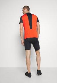 Ziener - NELIH - T-Shirt print - new red - 2