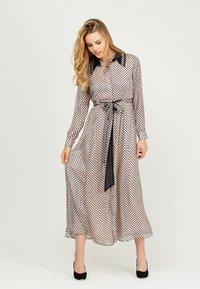 NIZA - LARGO CON ESTAMPADO LUNARES - Maxi dress - beige - 0
