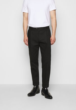 TREVOR - Trousers - black