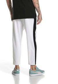 Puma - Tracksuit bottoms -  white - 2