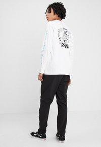 The North Face - TECH PANT - Spodnie treningowe - black/white - 2