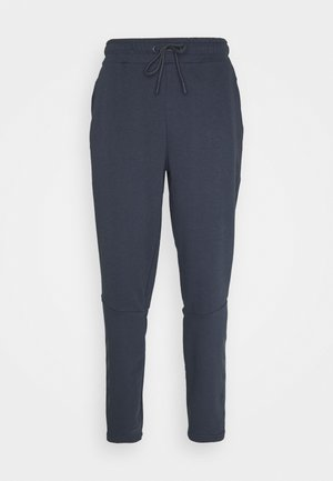 ISAM TAPERED PANTS - Tracksuit bottoms - blue nights