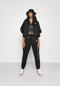 Nike Sportswear - AIR - Tracksuit bottoms - black/white - 3