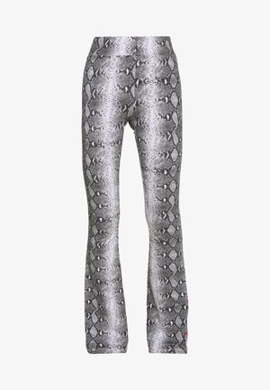 SIGNATURE SNAKE FLARED PANTS - Kalhoty - black/white/red