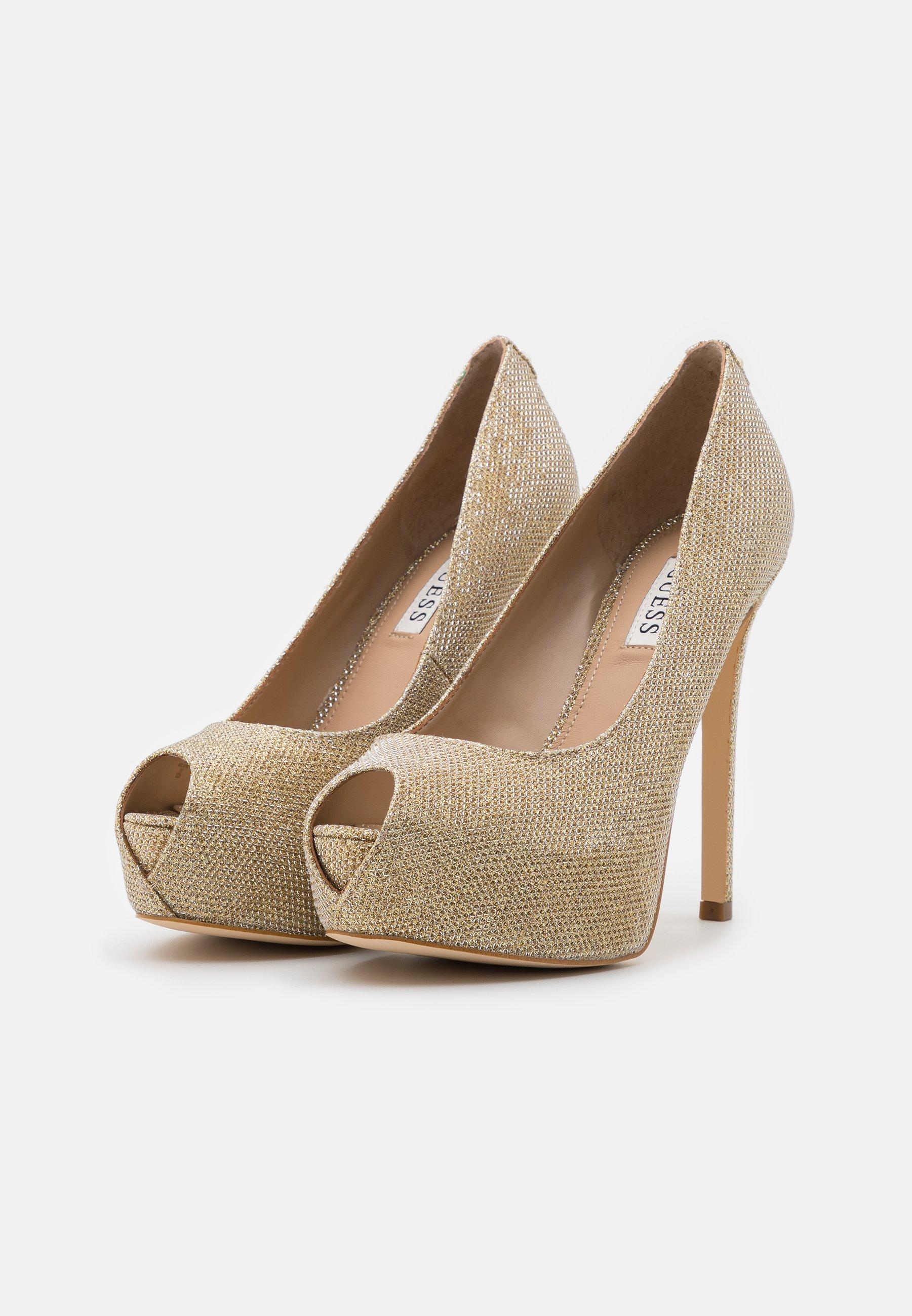 Compra Guess Peeptoes - gold | Calzado de mujer2020 mcNgy
