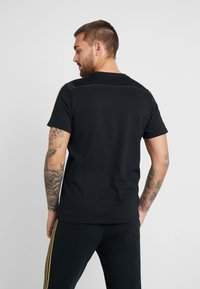 adidas Performance - REAL MADRID TEE - Club wear - black/gold - 2