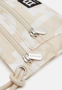 Marimekko - SMART TRAVELBAG LOGO BAG - Across body bag - beige/off-white - 3