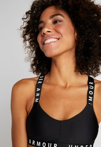 Under Armour - WORDMARK STRAPPY SPORTLETTE - Sport BH - black/white - 3