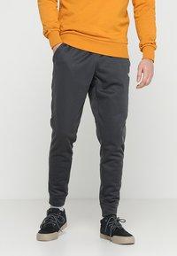 The North Face - MENS SURGENT CUFFED PANT - Träningsbyxor - dark grey heather - 0
