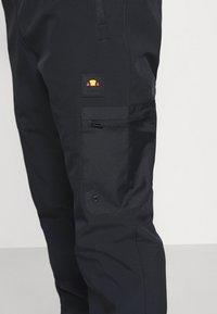 Ellesse - CABOTONE - Pantalones deportivos - black - 4