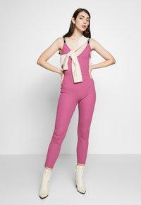 Nike Sportswear - Jumpsuit - mulberry rose - 1