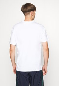 Levi's® - LEVI'S® X PEANUTS RELAXED FIT TEE UNISEX - Print T-shirt - bright white - 2