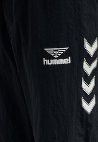 Hummel Hive - Tracksuit bottoms - dark navy - 7