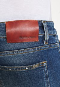Tigha - MORTEN REPAIRED - Slim fit jeans - mid blue - 4