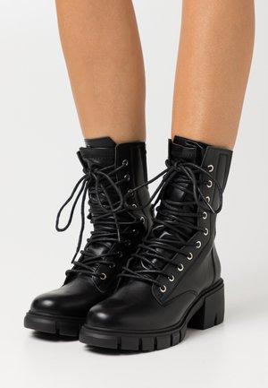 LACE UP EYELET - Lace-up ankle boots - black