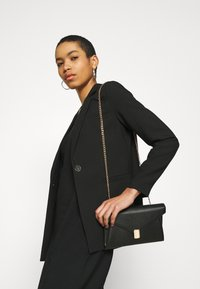 Banana Republic - V NECK MERROW EDGE SHEATH - Day dress - black - 3
