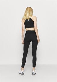 Puma - TRAIN - Leggings - black/white - 2