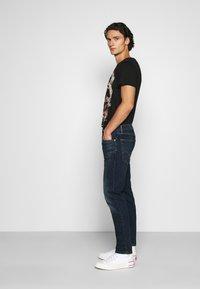 Levi's® - 502™ TAPER HI BALL - Jeans Tapered Fit - med indigo - 4