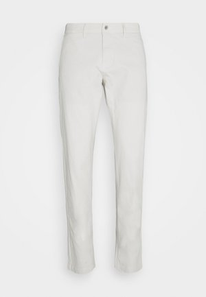 SMART FLEX TAPERED - Pantalones chinos - parchment