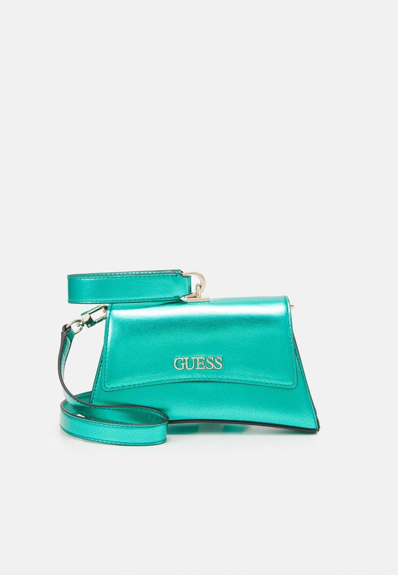 Guess - DEVIN CROSSBODY WRISTLET - Handbag - green