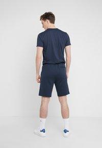 BOSS - HEADLO WIN - Pantalon de survêtement - blue/silver - 2
