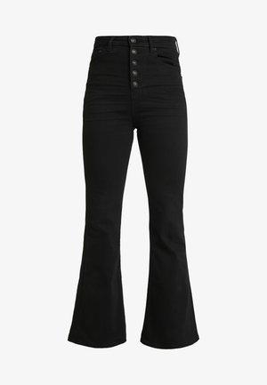 CURVY HIGHEST RISE - Bootcut jeans - bold black
