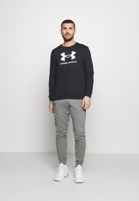 Under Armour - RIVAL - Tracksuit bottoms - pitch gray light heather - 1
