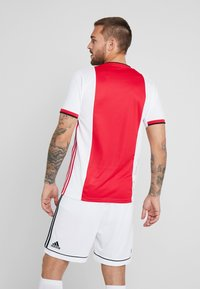 adidas Performance - AJAX AMSTERDAM H JSY - Club wear - red/white/black - 2